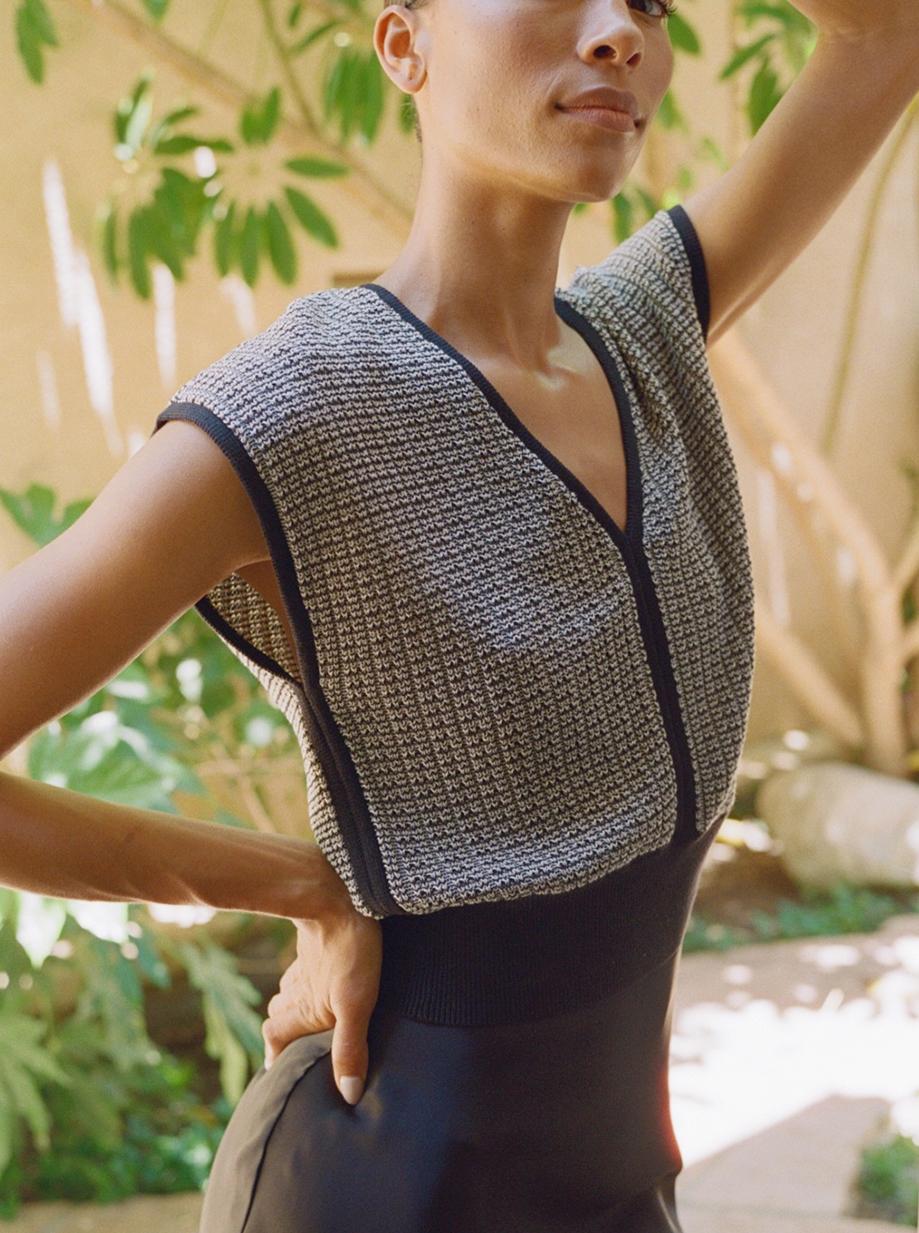 Woman standing outside in versatile knit sweater