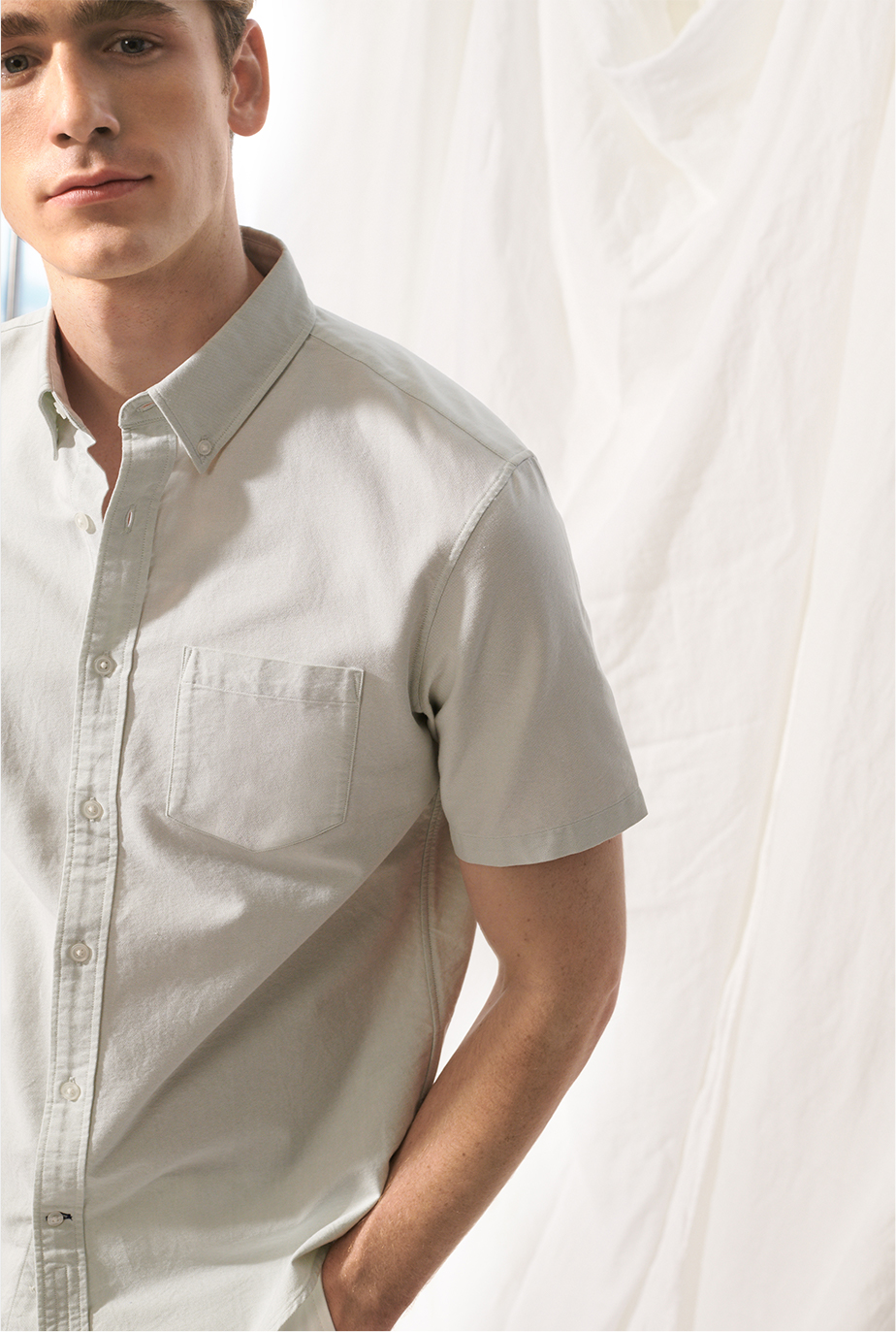 Man in slim fit button-up short sleeve shirt