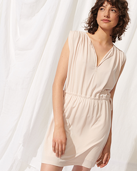 72f44f86 Woman in textured knits, lightweight sundress, and pleated romper