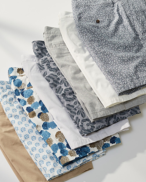 A stack of men's shorts in a variety of colors and patterns.
