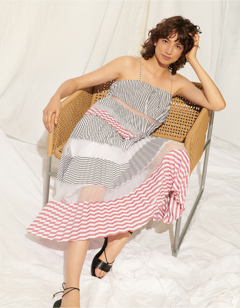 Woman in pleated striped sundress