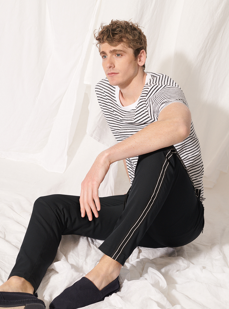 Man in easy track pants and striped crewneck tee