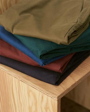 Women's plaid coats, pants, and silk blouses.