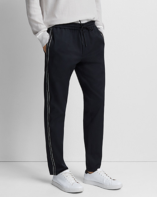 A pair of navy track pants.