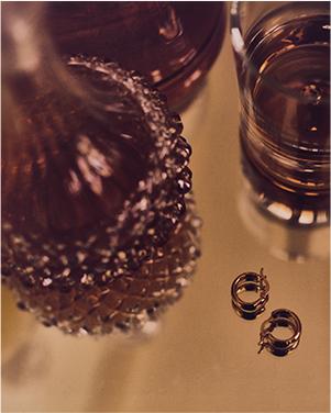 Gold hoop earrings and versatile midi-dress.