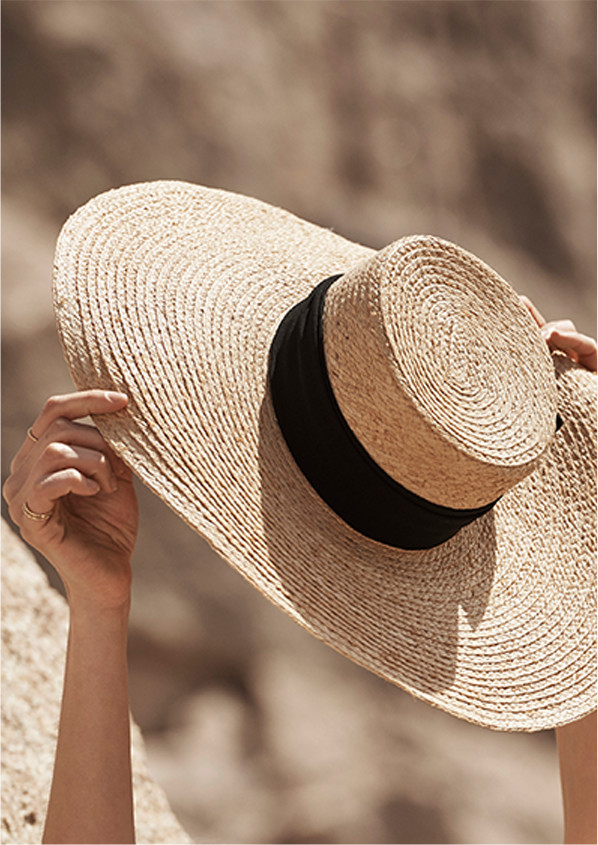 A woven straw hat in the sun.